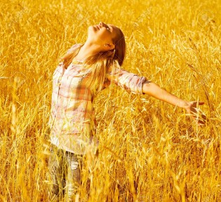 15427058-Image-of-pretty-young-woman-enjoying-autumn-rural-nature-active-teen-girl-standing-on-golden-dry-whe-Stock-Photo